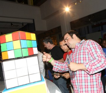 North American Champion Speed Cuber Anthony Brooks and TV personality George Duran attend the Cake-Off At Liberty Science Center In Honor Of Erno Rubik's Birthday on July 11, 2014 in Jersey City City.