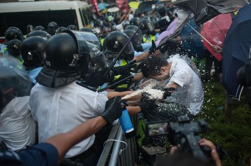 Pro-democracy protesters clash with riot police on Sept. 27, 2014 in Hong Kong.