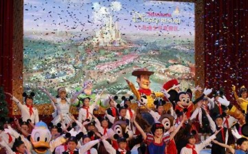 Dancers perform with some Disney characters at the groundbreaking ceremony in April.