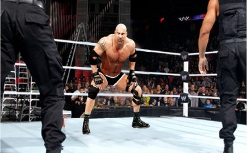 Goldberg getting ready to execute his signature move, The Spear.