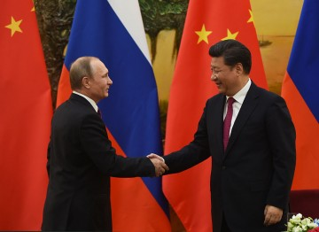 Chinese President Xi Jinping and Russian President Vladimir Putin make a joint statement during the latter's state visit in Beijing.