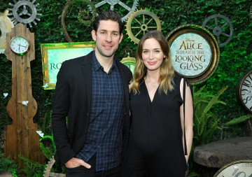John Krasinski (L) and Emily Blunt attend Disney's Alice Through the Looking Glass event on May 12, 2016 at Roseark in Los Angeles California.