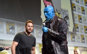"""Actors Chris Pratt (L) and Yondu (Michael Rooker) from Marvel Studios' 'Guardians Of The Galaxy Vol. 2"""" attend the San Diego Comic-Con International 2016 Marvel Panel in Hall H on July 23, 2016 in San Diego, California"""