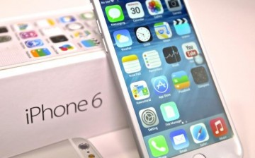 The iPhone 6 is freshly opened and leaning toward its box, which is the latest generation from Apple before iPhone 7's release this September.