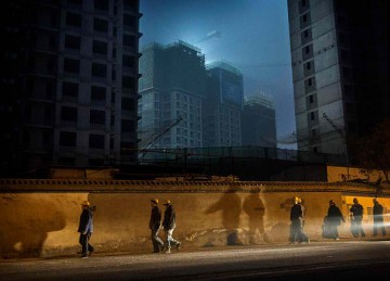 China is facing a real estate crisis because of slow urbanization.
