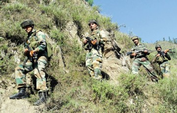 Indian Army patrol in the hills of Kashmir finds the going hard.