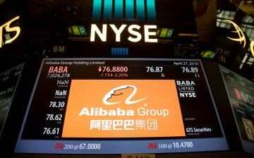 An Alibaba signage shows trading activity at the New York Stock Exchange.