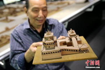 Wang Tailai shows his work in Xi'an, Shaanxi Province, on Oct. 20, 2016.