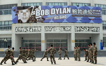 Chinese security personnel conduct drills outside the venue for U.S. music legend Bob Dylan's first concert in China in April 2011 in Beijing.