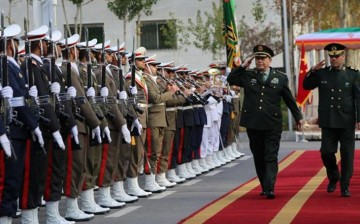 Chinese Defense Minister Gen. Chang Wanquan and Iranian Defense Minister Hossein Dakhan inspect a guard of honor in Tehran.