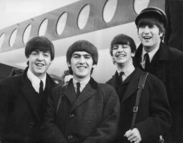 The Beatles, left to right, Paul McCartney, George Harrison, Ringo Starr and John Lennon (1940 - 1980) arrive at London Airport Feb. 6, 1964, after a trip to Paris.