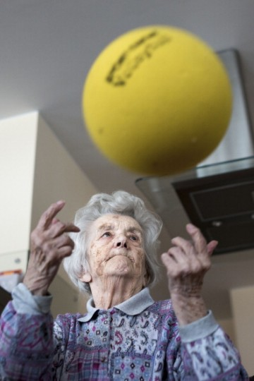 Day guest Helga, who has dementia, during a sport lesson in the geriatric day care facility of the German Red Cross (DRK, or Deutsches Rotes Kreuz) at Villa Albrecht on March 18, 2013 in Berlin, Germany.