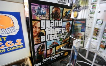 A poster promoting Grand Theft Auto V is displayed at the 8 Bit & Up video games shop in Manhattan's East Village on September 18, 2013 in New York City. The video game raked in more than $800 million in sales in its first 24 hours on the shelves.