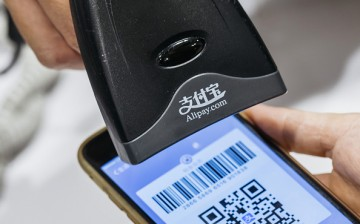 An Alipay user pays through a bar code scanned from his mobile phone.