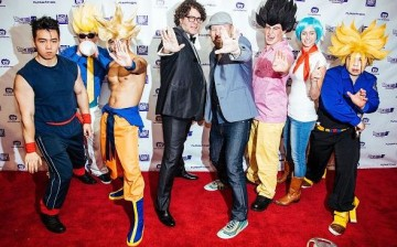 Christopher Sabat (L) and Sean Schemmel pose with fans in costumes at the 'Dragon Ball Z: Resurrection 'F'' premiere at AMC Empire 25 theater on August 3, 2015 in New York City.