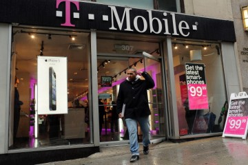 A man walks out of a Manhattan T-Mobile store in New York City.