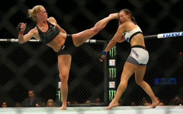 Holly Holm lands a hard head kick against Miesha Tate in their match at UFC 196 held last March 5, 2016.