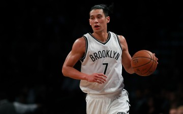 Jeremy Lin of the Brooklyn Nets dribbles up the court during first half of the preseason game against the Boston Celtics at Barclays Center on October 13, 2016 in New York City.