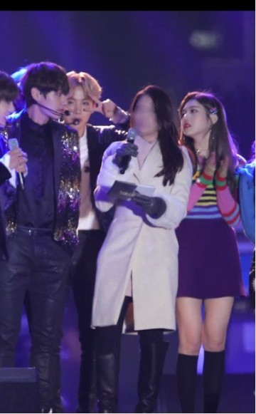 BTS' V and Red Velvet's Joy caught staring at each other on stage during a recent year-end event.