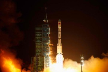 China's ambitious plan to explore Mars now comes with a shortlist of names and logos. Pictured here is the launching of the country's space laboratory module Tiangong-1.