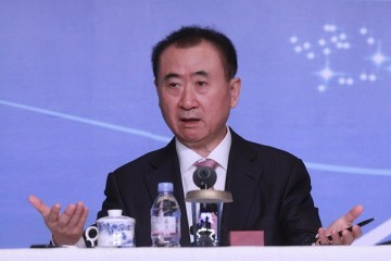 Wang Jianlin attends a press conference for the ppening af a Wanda movie park.