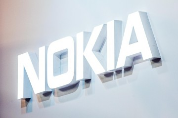 A logo sits illuminated outside the Nokia pavilion on the opening day of the World Mobile Congress at the Fira Gran Via Complex on February 22, 2016 in Barcelona, Spain.