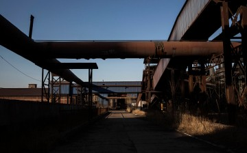 Building facilities stand in the abandoned Qingquan Steel plant which closed in 2014 and became one of several so-called