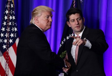 U.S. President Donald Trump (L) shakes hands with Speaker of the House Rep. Paul Ryan (R-WI) (R) during a luncheon at the Congress of Tomorrow Republican Member Retreat.