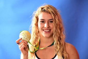 Helen Maroulis of the United States poses for a photo with her gold medal on the Today show set on Copacabana Beach on August 19, 2016 in Rio de Janeiro, Brazil.