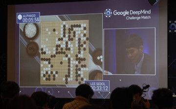 South Korean professional Go player Lee Sedol is seen on the screen during the Google DeepMind Challenge Match against Google's artificial intelligence program, AlphaGo.