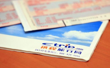 Airplane tickets and a Ctrip.com envelope on a table in Beijing, China.