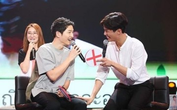 Song Joong-Ki and Park Bo-Gum laugh during the fan meeting of the latter in Bangkok, Thailand on Feb. 11, 2017.