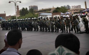 Anti-riot personnel guard the Xinjiang area as threats from terrorists rise.