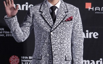 Actor T.O.P of Bigbang arrives for the marie claire Asia Star Awards during the 18th Busan International Film Festival on October 5, 2013 in Busan, South Korea.