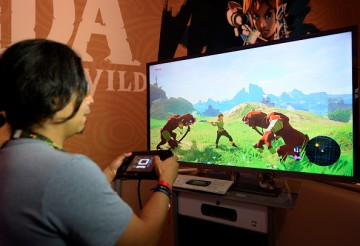 Gamers try out the new to play the new video game 'The Legend of Zelda: Breath of the Wild' in the Nintendo booth during the annual E3 2016 gaming conference at the Los Angeles Convention Center on June 14, 2016 in Los Angeles, California.