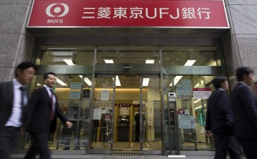 Pedestrians walk past a Bank of Tokyo-Mitsubishi UFJ Ltd. branch, a unit of Mitsubishi UFJ Financial Group Inc. (MUFG).