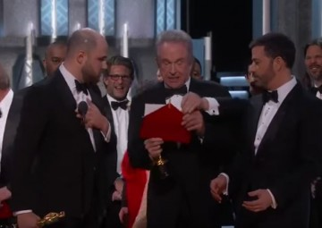 Jimmy Kimmel (L), Warren Beatty and 'La La Land' producer Jordan Horowitz announce 'Moonlight' as correct winner of Best Picture award at the Oscars 2017.
