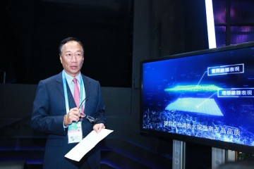 Terry Gou Tai-ming, founder and chairman of Taiwan's Foxconn Technology, speaks at the Foxconn booth during the 3rd World Internet Conference.