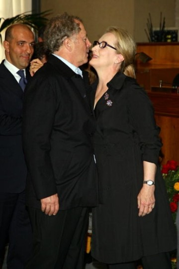 Meryl Streep kisses her husband Don Gummer as she receives the Marc'Aurelio award at a ceremony during Day 9 of the 4th International Rome Film Festival held at the Capital Hill on October 23, 2009 in Rome, Italy.