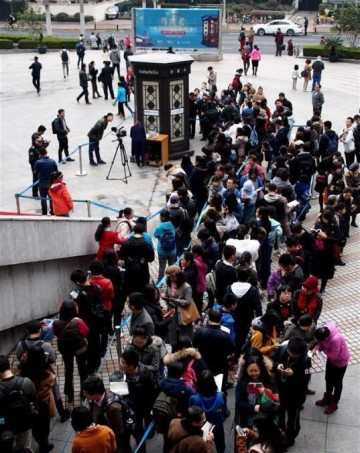 People wait in line for a reading pavilion at Knowledge Square in front of Shanghai Library on March 5, 2017.