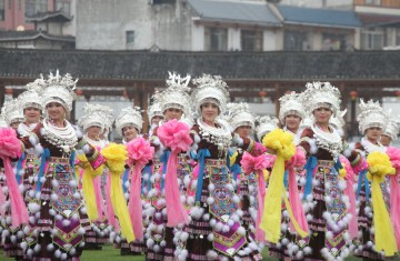 Women of Miao ethnic group dance at a square in Rongshui county, Guangxi Zhuang autonomous region, on March 7, to celebrate the International Women's Day.