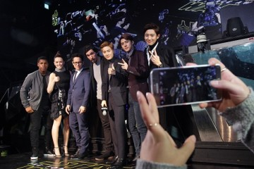 John Boyega, Daisy Ridley, J.J. Abrams and Adam Driver pose for their selfie with South Korean boy band EXO during the event for fans ahead of 'Star Wars: The Force Awakens' South Korea premiere.