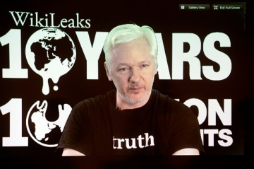 WikiLeaks founder Julian Assange participates via video link at a news conference marking the 10th anniversary of the secrecy-spilling group.