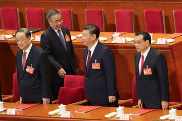 Chinese President Xi Jinping, Premier Li Keqiang and Yu Zhengsheng attend the closing meeting of the Fifth Session of the 12th National People's Congress.