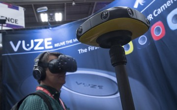 An attendee wears a HTC Vive virtual reality headset (VR) as he views data from a Vuze 360 degree camera at the 2017 South By Southwest (SXSW) Interactive Festival.