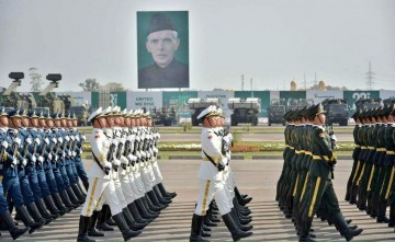 Chinese troops march with the Pakistani army in celebration of Pakistan Day.