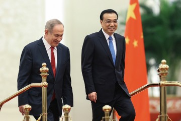 Chinese Premier Li Keqiang chats with Israel Prime Minister Benjamin Netanyahu during a welcoming ceremony inside the Great Hall of the People on March 20, 2017 in Beijing, China.
