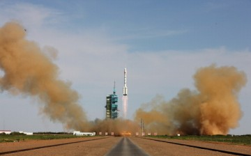 The Long March-2F rocket blasts off from the launch pad at the Jiuquan Satellite Launch Center on June 11, 2013, in Jiuquan, Gansu Province, China.