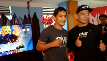 """Asian MMA fighters Eduard """"Landslide"""" Folayang and Ev """"E.T."""" Ting face off in front of the media at the Top of the Citi Restaurant in Citibank Tower on March 28, 2017 in Manila, Philippines."""