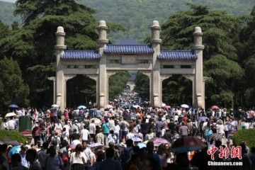 Chinese tourists celebrating International Workers' Day